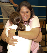 photo of two people at SportsAbility hugging